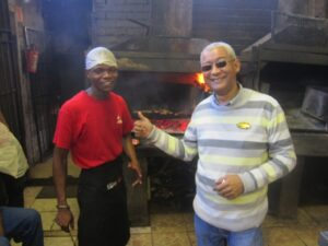 Mishek (left) and Cledwyn (right) before the awesome fires of Mzoli's in Guguletu Township, outside of Cape Town