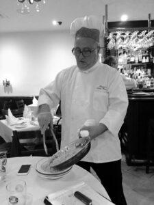 Pietro serving pasta