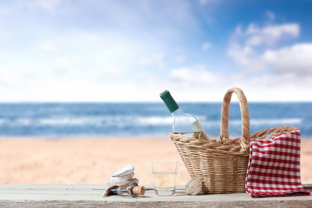Picnic for one Person with White Wine at the Sea