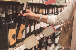 Women_Wine_Retailers_Woman_Purchasing_Wine_Store